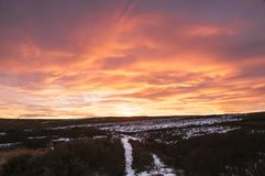 High Crag path sunset. Cold winter Sunset over High Crag rocks in Nidderdale, North Yorkshire, England. December 2017 Royalty Free Stock Image