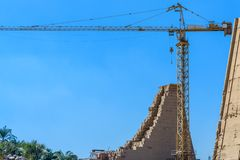 High crane on ruins of the ancient Karnak temple. Luxor, Egypt. High crane on ruins of ancient Karnak temple. Luxor, Egypt royalty free stock photography