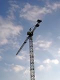 High crane silhouette on blue sky, clouds, Royalty Free Stock Images