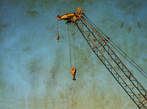 High Cranes against a grungy texture Stock Photo