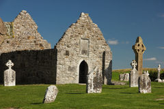 High Cross and temple. Clonmacnoise. Ireland. The south cross and temple Doolin or Dowling in the medieval monastery of Clonmacnoise. Ireland Stock Photos