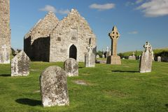 High Cross and temple. Clonmacnoise. Ireland. The south cross and temple Doolin or Dowling in the medieval monastery of Clonmacnoise. Ireland Royalty Free Stock Image