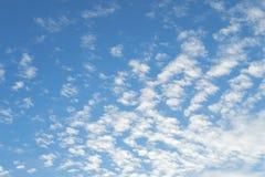 High Cumulus or Altocumulus clouds in deep blue spring sky Stock Photos