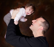 High in dad's hands Royalty Free Stock Photo