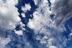 High dark blue sky with clouds Royalty Free Stock Photography