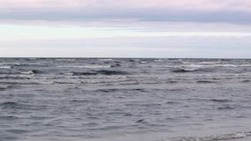 High definition footage of the sea and the sky at sunset time. Slow motion stock video footage