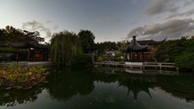 High Definition Time Lapse Movie of Moving Clouds and Water Reflection over Lake in Lan Su Chinese Garden in Portland Oregon 1080p stock footage