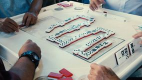 Elderly Domino Game Players Video. High definition video of elderly individuals playing the popular domino game at the historic Domino Park in Little Havana in stock video