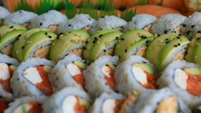 Video of fresh sushi rolls prepared with both raw and cooked ingredients 1080p stock footage