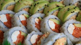 Video of fresh sushi rolls prepared with both raw and cooked ingredients 1080p stock video
