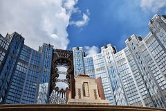 High density residential building in Hong Kong with blue sky in the background . High density residential building in Hong Kong with blue sky and white clouds royalty free stock images