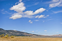 High Desert, Nevada. Washoe Lake extends across the distant landscape under bold white clouds and blue sky in the high desert , on the east side of the Sierra royalty free stock photo