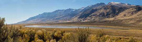 High desert in Oregon. A seasonal lake and high desert brush in the valley adjacent to the Steens Mountains in eastern Oregon stock images