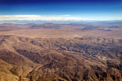 High Desert in South America. Dry desert and hills with snow capped mountains in the background somewhere over South America royalty free stock photo