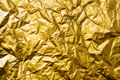High detailed abstract crumpled gold foil texture. Royalty Free Stock Photos