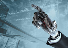 High detailed robotic hand in business suit pointing with index finger Stock Images