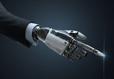 High detailed robotic hand in business suit touching virtual point with index finge Stock Photography