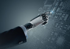 High detailed robotic hand touching digital circuit board with index finge Stock Images