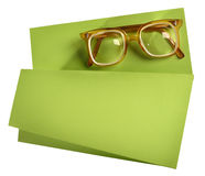 High diopter retro eyeglasses with yellow frame on green creative support. Retro eyeglasses with yellow frame on creative support made of green paper stock photos