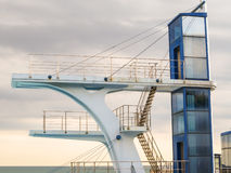 High diving tower. Diving tower and cloudy sky as background Royalty Free Stock Image