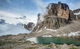 Clouds Break over the Dolomite Mountains. High in the Dolomite Mountains of Italy, Clouds Break against the Spine of Cima Pisciadu Stock Photos