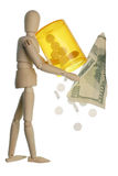 High drug prices concept. Wooden figurine holding a large pill vial with pills falling out of it and a One hundred dollar bill airplane flying off. Isolated on stock image