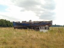 High And Dry. Boat wreck in a field, in the Lincolnshire countryside Royalty Free Stock Images
