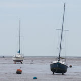 High and Dry. Yachts standing high on their keels at a winter low tide in the Thames Estuary, Essex, England, UK Royalty Free Stock Photos