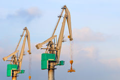 High dynamic range impression of quay cranes. Container terminal scene in the Port of Rotterdam against Stock Images