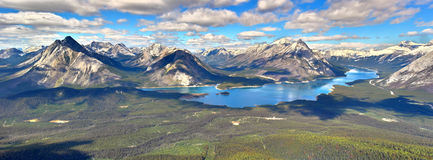 High Dynamic Range mountain scene of kananaskis lake. Partly cloudy skies over the mountain lake and end of summer scenery royalty free stock image