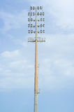 High electric floodlight pole in stadium Royalty Free Stock Photo