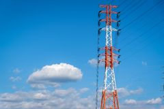 High Electric power station on blue sky background stock photography