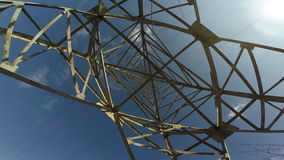 High electrical pylon construction from beneath and camera rotation, 4K stock footage