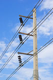 High electricity post and cable line with blue sky Stock Photos