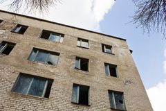 High  empty building with broken windows Stock Images