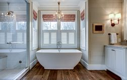 Free High End Bathroom With Large White Bathtub And Shiplap Siding Royalty Free Stock Photo - 165693945