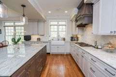 High End Kitchen. Hard wood floors  Granite Countertop Interior home Royalty Free Stock Images