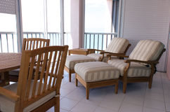 High end lanai. View of outside furniture on screened in lanai in florida Royalty Free Stock Photos