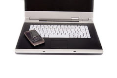 High-end laptop and modern smartphone on it. Royalty Free Stock Photo
