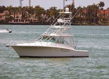 High End Sport Fishing Boat With Flying Bridge. Sport fishing boat with flying bridge idling off Magnolia Island on the Florida Intra-coastal Waterway near Miami stock image