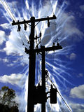 High Energy. Composition of the silhoutte of a transformer post struck by lightning stock photos