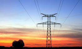 High Energy. Electricity pylons, over a sunset sky Stock Photo