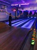 Neon cosmic bowling alley fun night! royalty free stock photo