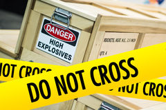 High Explosives Danger. Concept with Yellow Caution Tape Saying Do Not Cross Stock Images