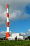 High factory chimney on blue sky Royalty Free Stock Images