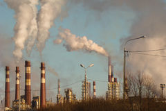 High factory chimneys. Smoke coming out of many high factory chimneys Stock Photos