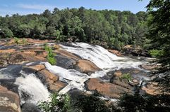 High Falls, Georgia. Towaliga River cascades over huge rock formations on a clear early summer day at High Falls State Park, Georgia Stock Photos