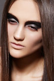 High fashion female model. Evening glitter make-up Stock Image