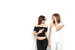 High-fashion. Glamorous stylish young women model. With red lips in a black and white bright hipster clothes and sunglasses. They laugh, rejoice, rage, indulge Royalty Free Stock Photo