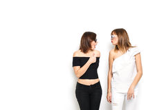 High-fashion. Glamorous stylish young women model. With red lips in a black and white bright hipster clothes and sunglasses. They laugh, rejoice, rage, indulge Royalty Free Stock Photography